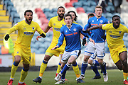 Jim McNulty challenges from a corner during the EFL Sky Bet League 1 match between Rochdale and AFC Wimbledon at Spotland, Rochdale, England on 17 March 2018. Picture by Daniel Youngs.