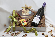An open gift set of wine and chocolate