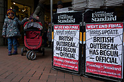 On the day that the UK Government's Chief Scientific Advisor, Sir Patrick Vallance said that the Coronavirus Covid-19 outbreak was now spreading person to person in the UK, pedestrians walk past the latest news headline from the capital's London Evening Standard newspaper is seen outside Embankment underground station, on 6th March 2020, in London, England.
