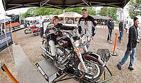All revved up but nowhere to go... as visitors to the Harley Davidson booth get to try a simulated spin on a Harley during the 2011 Laconia Motorcycle Rally Week at Weirs Beach.  (Karen Bobotas/for the Laconia Daily Sun)