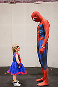 UNITED KINGDOM, London: 27 May 2018 Cosplay fans Thomas Dyke and his daughter Lilly, aged 4, have a chat before making an entrance at the MCM London Comic Con earlier today. The three day comic convention, which is held at London's ExCeL, was visited by thousands of avid cosplay fans and enthusiasts. Rick Findler / Story Picture Agency