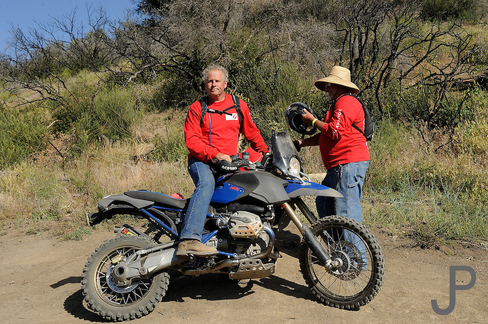 Del Christensen on BMW HP2 motorcycle prepared the course for the BMW Adventure Challenge
