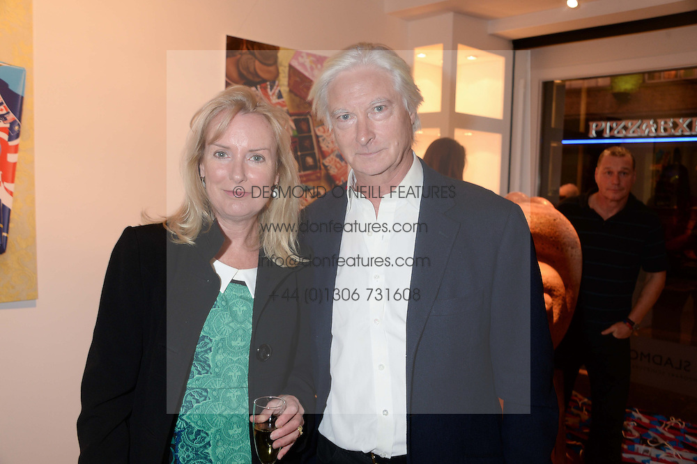 SARAH MACMILLAN and PRINCE NICHOLAS VON PREUSSEN at a reception to launch Prestat's special edition of their award-winning chocolate bars to raise money for the charity Walking with the Wounded held at Sladmore Gallery, Bruton Place, London on 10th October 2013.
