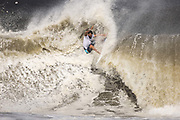 Brazil's Italo Ferreira competes during the men's Surfing gold medal final at the Tsurigasaki Surfing Beach, in Chiba, on July 27, 2021 during the Tokyo 2020 Olympic Games. (Photo by Yuki IWAMURA / AFP)