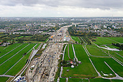 Nederland, Zuid-Holland, Midden-Delfland, 23-10-2013; aanleg van de verlengde A4 (A4 Delft-Schiedam) gezien naar Schiedam-Vlaardingen.<br /> Construction of the extended A4 (A4 Delft-Schiedam) between Vlaardingen and Schiedam.<br /> luchtfoto (toeslag op standaard tarieven);<br /> aerial photo (additional fee required);<br /> copyright foto/photo Siebe Swart.