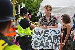 © Licensed to London News Pictures. 05/08/2013. Balcombe, UK. People protesting against oil exploration in Balcombe, West Sussex on Monday, August 05, 2013, after energy company Cuadrilla began drilling at the site. Photo credit : Aiden Jordan/LNP