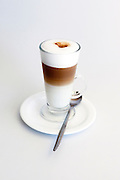 A glass of Cappuccino in three layers On white background