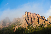 Granite rock spires in clouds above McMurdy Park, Lost Creek Wilderness, Colorado.