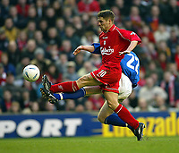Fotball: Liverpool Michael Owen and ex-Liverpool defender Birmingham City's David Burrows during the FA Cup 3rd Round match at Anfield. Liverpool won 3-0. Saturday 5th January 2002.<br /><br />Foto: David Rawcliffe, Digitalsport