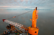 Alaska, Cook Inlet. A worker changes a lightbulb on top of the offshore oil platform XTO in Cook Inlet.