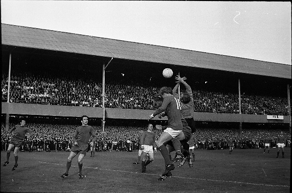 Waterford FC vs Manchester United at Lansdowne Road..1968..18.09.1968..09.18.1968..18th September 1968..Waterford FC as champions of the league of Ireland drew Manchester United, the European Champions,in the first round of this years competition.The Waterford team was as follows: Peter Thomas, Peter Bryan, Noel Griffin, Vinny Maguire, Jackie Morley, Jimmy McGeough, Al Casey, Alfie Hale, John O'Neill, Shamie Coad and Johnny Matthews. Manchester United won the tie 3 -1 with Denis Law being the man of the match..Alex Stepney,Tony Dunne,Francis Burns,Paddy Crerand,.Bill Foulkes,Nobby Stiles,George Best,Denis Law,.Bobby Charlton,David Sadler,Brian Kidd were the starting eleven for United...Picture shows Denis Law challenging Peter Thomas for a high ball.
