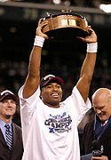 Jan 22, 2006, Seattle, Washington, USA;  Shaun Alexander of the Seattle Seahawks raises the George Halas Trophy after the Seahawks beat the Carolina Panthers in the NFC Championship game to advance to the Super Bowl to play the  Pittsburgh Steelers.