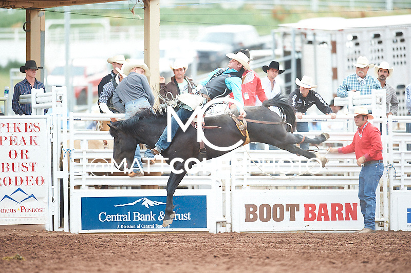 Bareback rider Kyle Brennecke of Grain Valley, MO rides Excaliber at the Pikes Peak or Bust Rodeo in Colorado Springs, CO.<br /> <br /> <br /> UNEDITED LOW-RES PREVIEW<br /> <br /> <br /> File shown may be an unedited low resolution version used as a proof only. All prints are 100% guaranteed for quality. Sizes 8x10+ come with a version for personal social media. I am currently not selling downloads for commercial/brand use.