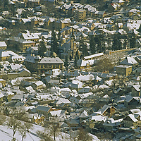 Elevated view of snow-covered old quarter of this mountain town.