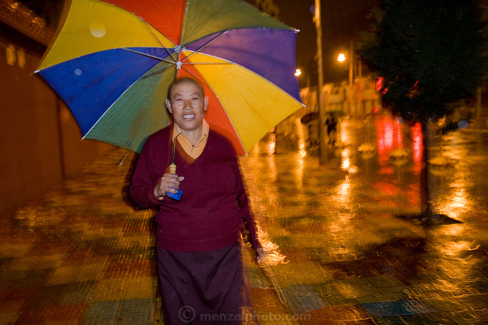 Tsul Tim Lhamu, head nun at the Lhasaani Tsang Kung Nunnery, Lhasa, Tibet, taking her early morning walk around the city. (Tsul Tim Lhamu was photographed for the book project What I Eat: Around the World in 80 Diets.) MODEL RELEASED.