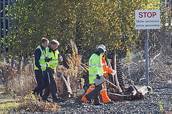 © Licensed to London News Pictures . 27/10/2012 . Warrington , UK . Police and forensic scenes of crime examiners search an area of railway track near to Folly Lane , Warrington today (27th October 2012) where seven stolen munitions packages were discovered . The North West Counter Terrorism Unit is investigating after munitions were stolen from a freight train between Cumbria and Oxfordshire on Wednesday 24th October . Photo credit : Joel Goodman/LNP