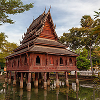 The wooden temple Wat Thung Si Muang stand in the middle of a pond. The temple is situated in Ubon Ratchathani.