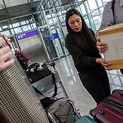 Vanessa Mae Rodel (42) repacks her bags in Hong Kong International Airport on March 25, 2019, before flying to Canada. / Photo: Maria de la Guardia
