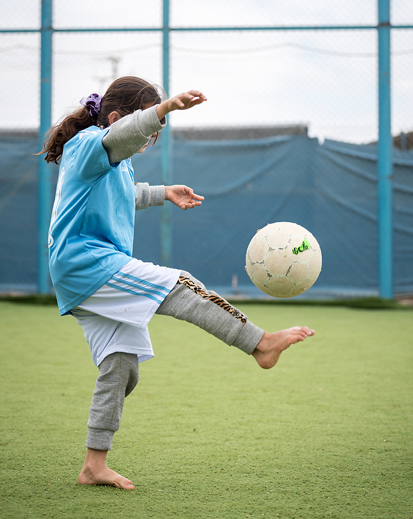 20 February 2020, Za'atari Camp, Jordan: A girl practices keeping the ball in the air, during football practice for girls in the Peace Oasis, a Lutheran World Federation space in the Za'atari Camp where Syrian refugees are offered a variety of activities on psychosocial support, including counselling, life skills trainings and other activities.