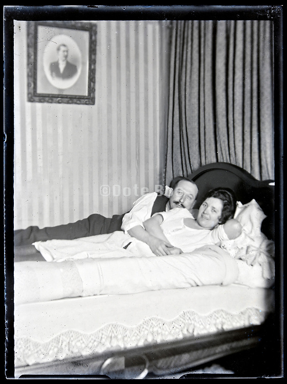 middle aged couple happy together in bed France, circa 1930s