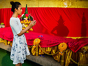 15 NOVEMBER 2018 - BANGKOK, THAILAND: A woman prays during the red cloth ceremony at Wat Saket, also called the Golden Mount. Wat Saket is on a man-made hill in the historic section of Bangkok. The temple has golden spire that is 260 feet high, which was the highest point in Bangkok for more than 100 years. The temple construction began in the 1800s during the reign of King Rama III and was completed in the reign of King Rama IV. A  red cloth (reminiscent of a monk's robe) is placed around the chedi at the top of  Golden Mount during the weeks leading up to the Thai holy day of Loy Krathong, which is November 22 this year.     PHOTO BY JACK KURTZ