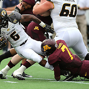ORLANDO, FL - JANUARY 01:  Marcus Murphy #6 of the Missouri Tigers gets tackled by Damarius Travis #7 of the Minnesota Golden Gophers during the Buffalo Wild Wings Citrus Bowl at the Florida Citrus Bowl on January 1, 2015 in Orlando, Florida. (Photo by Alex Menendez/Getty Images) *** Local Caption *** Marcus Murphy; Damarius Travis