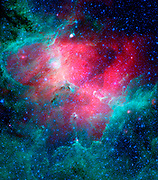 The Eagle nebula, an industrious star-making factory located 7,000 light-years away in the Serpens constellation. The image shows the region's entire network of turbulent clouds and newborn stars in infrared light. Hubble Space Telescope (HST),Spitzer Space Telescope.