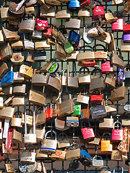 Love Locks fixed to Hohenzollern Bridge which crosses the River Rhine in Cologne Germany
