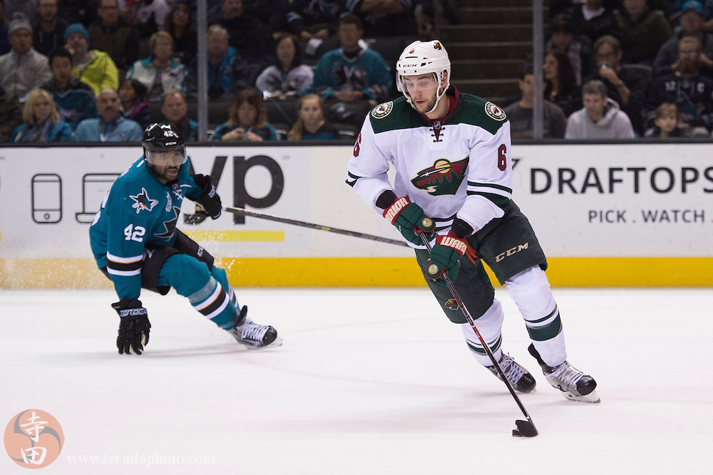 December 12, 2015; San Jose, CA, USA; Minnesota Wild defenseman Marco Scandella (6) controls the puck against San Jose Sharks right wing Joel Ward (42) during the second period at SAP Center at San Jose. The Wild defeated the Sharks 2-0.