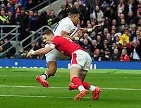 Rugby Union - 2020 Guinness Six Nations Championship - England vs. Wales<br /> <br /> Anthony Watson of England dives over the line for his try as Liam Williams tackles in vain, at Twickenham.<br /> <br /> COLORSPORT/ANDREW COWIE
