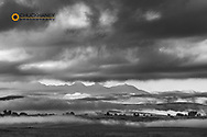 Clearing storm clouds over the Flathead River Valley with Mission Mountains in Lake Copunty, Montana, USA