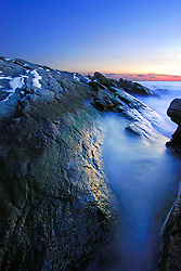 The rocky granite coast juts out into the cold North Atlantic Ocean near Newport Rhode Island, forming a small peninsula which is an important refuge for wildlife and people alike.