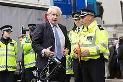 © Licensed to London News Pictures. 27/05/2014. London, UK. Mayor of London, Boris Johnson at an Operation Safeway road safety event held at the junction of Tooley Street and Tower Bridge Road in London on 27th May 2014. A seven week pilot of Operation Safeway was carried out late last year in response to a series of tragic cyclist and pedestrian deaths on London's roads, where Police officers were deployed at key junctions across the capital, enforcing road safety and giving advice to road users during rush hours. Operation Safeway will now continue at key junctions across London to build awareness and promote safety for all road users. Photo credit : Vickie Flores/LNP