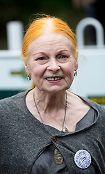 © London News Pictures. 16/08/2013. Balcombe, UK. Designer Vivienne Westwood arriving at Balcombe train station to join Campaigners demonstrating outside the Cuadrilla drilling site in Balcombe, West Sussex which has been earmarked for fracking. Cuadrilla has temporarily ceased drilling at the site under advice from the police after campaign group No Dash For Gas threatened a weekend of civil disobedience. Photo credit: Ben Cawthra/LNP