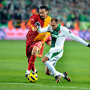 Bursaspor's Sercan YILDIRIM (R) and Galatasaray's Servet CETIN (L) during their Turkish soccer super league match Bursaspor between Galatasaray at Ataturk Stadium in Bursa Turkey on Saturday, 29 January 2011. Photo by TURKPIX