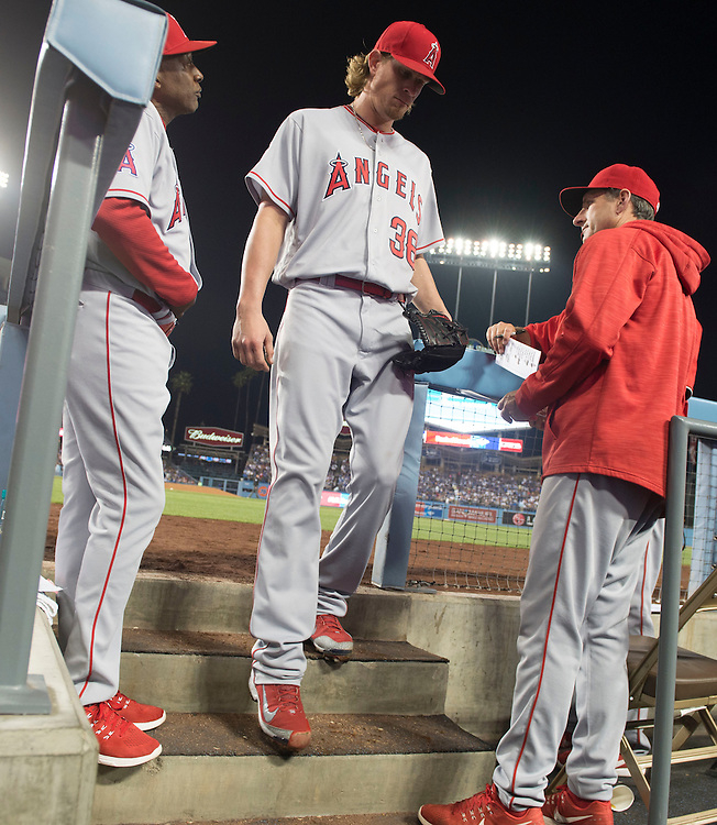 The Angels' Jered Weaver is finished for the night as he exits the game after the seventh inning during the Angels 5-1 loss to the Dodgers Tuesday night at Dodger Stadium.<br /> <br /> / //ADDITIONAL INFO:   <br /> <br /> angels.0518.kjs  ---  Photo by KEVIN SULLIVAN / Orange County Register  -- 5/17/16<br /> <br /> The Los Angeles Angels take on the Los Angeles Dodgers in inter-league play at Dodger Stadium Tuesday night.