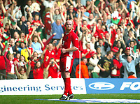 Photo: Scott Heavey<br />Wales V Azerbaijan. 29/03/03.<br />John hartson makes it 3-0 to Wales during this afternoons Euro 2004 Group 9 qualifying match at the Millenium stadium in Cardiff.