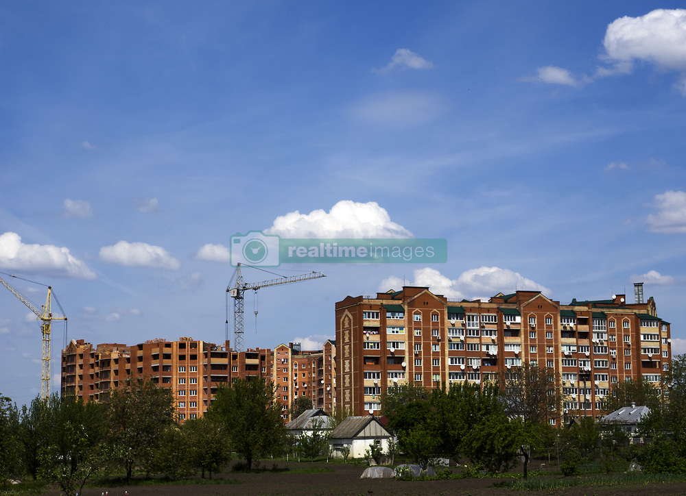May 10, 2015 - Vegetable garden in the private sector against the backdrop of the condo buildings in the suburb of Kiev, Borispol (Credit Image: © Igor Golovniov/ZUMA Wire)