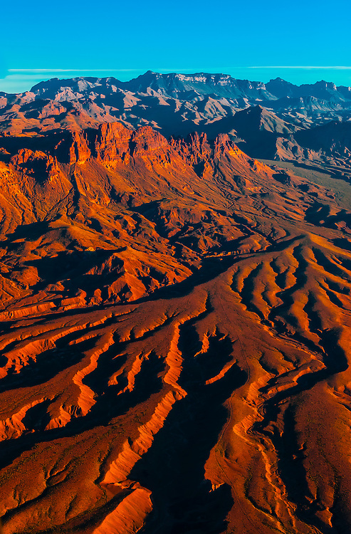 Aerial view of igneous peaks with eroded sediments and the Chisos Mountains in background, Big Bend National Park, Texas USA.