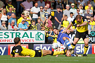 Sheffield Wednesday midfielder George Boyd (21) tackles for the ball against Burton Albion defender Ben Turner (6) and Burton Albion defender Jake Buxton (23) during the EFL Sky Bet Championship match between Burton Albion and Sheffield Wednesday at the Pirelli Stadium, Burton upon Trent, England on 26 August 2017. Photo by Richard Holmes.
