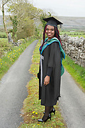 """18/04/2017 REPRO FREE:  <br /> MFA graduate  Joan Nanfuka  at the 13th conferring ceremony, held in the Minstrels gallery the 16th century Newtown Castle at the heart of the BCA campus, exemplifies the continued success of the Burren's  alternative model of art education . <br /> The Irish and  international graduates included Elizabeth Matthews, conferred with  a PhD for her research on Utopian studies , and six international graduates whose work on display in the BCA gallery addressed the ultimate question, """"who am I called to be"""" In her address President of the college Mary Hawkes Greene referred to the unique place based educational  model  committed to  individual student centred  education accredited by NUIGalway , and how it effectively  embraces the often conflicting forces of the global and the local, the public and the private as well as the collective and the individual. <br /> .  Photo:Andrew Downes, xposure"""