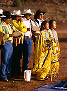 Carla and Carmin Goseyun facing sunrise with the Burnette Singers, Carla Goseyun's White Mountain Apache Traditional Sunrise Ceremony, Whiteriver, Arizona.  Please Note: A small extra licensing fee needs to be paid to the Goseyun Family for usage of this photo. Contact Fred Hirschmann for more information. Thanks.