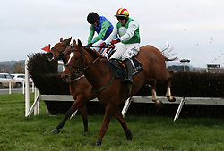 Crazywork De Vassy ridden by Mark Enright (right) clears the last on the way to winning the Toals Bookmakers Handicap Steeplechase during day one of the Down Royal festival at Down Royal racecourse.