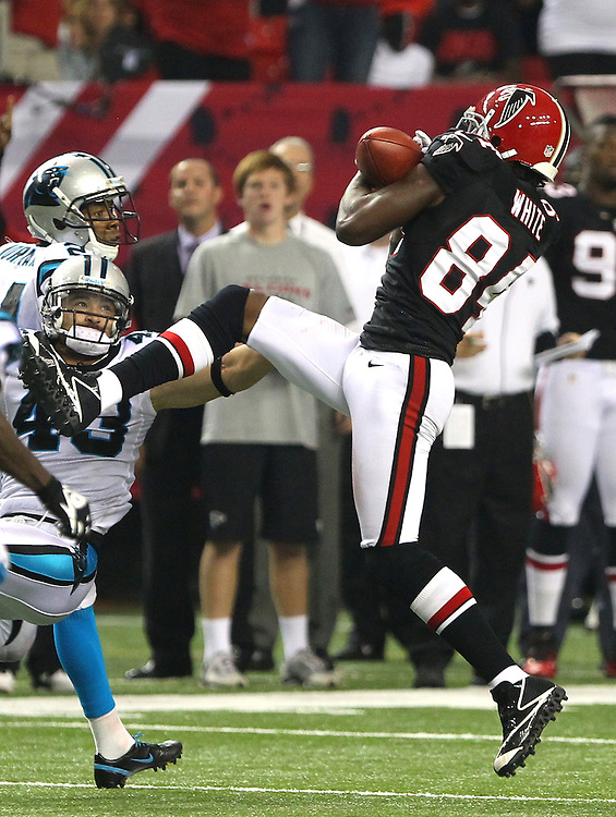 WR Roddy White of the Atlanta Falcons catches a 50 yd pass late in the 4th quarter to set up a last second game winning FG vs the Carolina Panthers.
