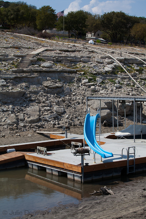 Slides that now end in mud instead of water at a dried up branch of Lake Travis in Austin Texas.The Drought in Texas will have long term environmental and finical impact.
