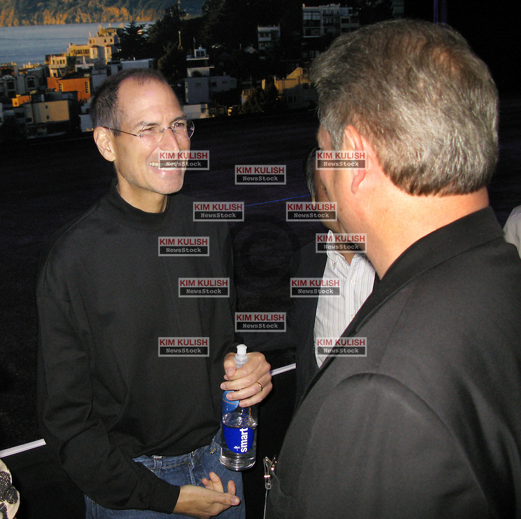 Steve Jobs laughs with Al Gore at  the Apple 2008 WWDC in San Francisco, CA.  Photo by Kim Kulish
