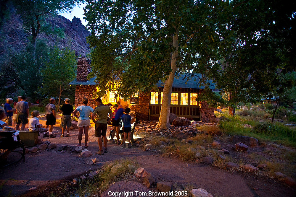 A July morning when first light at Phantom Ranch comes early and the day temperatures are still  cool,  Those who have made a reservation for breakfast  wait for the staff to open the door to the canteen so they can get their meal and be off on the trail before the day's heat.