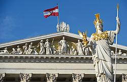 THEMENBILD - Wiener Eistraum, Eislaufen am Rathausplatz in Wien, das Bild wurde am 25. Jaenner 2012 aufgebommen, im Bild Statue Pallas Athene, im Hintergrund ein Teil des Parlaments mit oesterreichischer Flagge, AUT, EXPA Pictures © 2012, PhotoCredit: EXPA/ M. Gruber