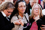 "15 JANUARY 2010 - TUCSON, AZ:    Safeway employees SARAH PREWITT-CHO (left), DAWN GALLAGHER (center, dark hair) and SHAYNE SPUDE (right) comfort each other at the memorial for the victims of a a mass shooting in Tucson, AZ, Saturday, January 15, one week after the shooting. Six people were killed and 14 injured in the shooting spree at a ""Congress on Your Corner"" event hosted by Arizona Congresswoman Gabrielle Giffords at a Safeway grocery store in north Tucson on January 8. Congresswoman Giffords, the intended target of the attack, was shot in the head and seriously injured in the attack but is recovering. Doctors announced that they removed her breathing tube Saturday, one week after the attack. The alleged gunman, Jared Lee Loughner, was wrestled to the ground by bystanders when he stopped shooting to reload the Glock 19 semi-automatic pistol. Loughner is currently in federal custody at a medium security prison near Phoenix.    PHOTO BY JACK KURTZ"