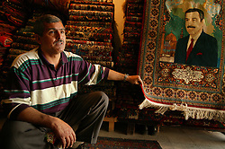 Basem Khalaf, 49, is seen inside his shop, Al Taynar Antiques, in Baghdad, Iraq, March 4, 2004. Since the war, Khalaf has moved and expanded his store but is still distrustful of the American occupation.